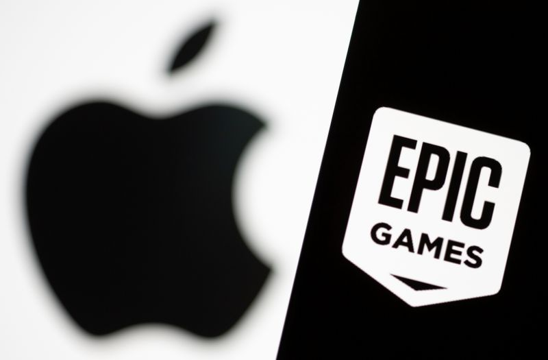 Smartphone with Epic Games logo is seen in front of Apple logo in this illustration