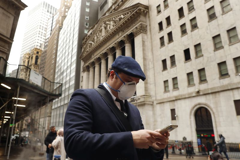 FILE PHOTO: FILE PHOTO: A man walks on Wall Street in New York, U.S.